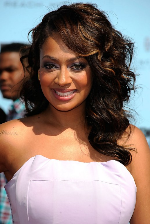 La La Anthony Side Parted Curly Hairstyle