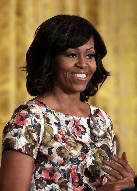 micro braid updo hairstyles : Michelle Obama Hairstyle -medium black wavy hairstyle with side swept ...