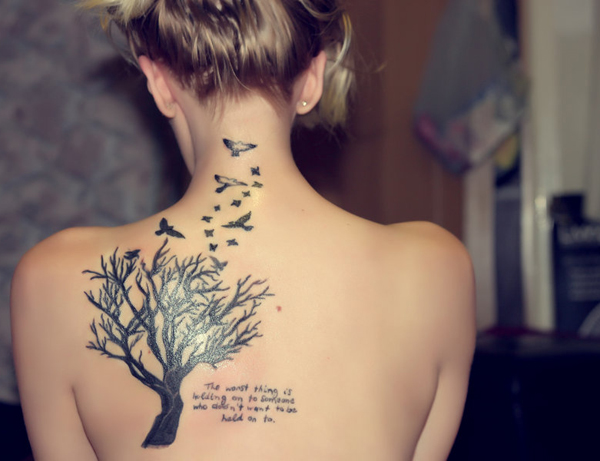 Bird tattoo with tree