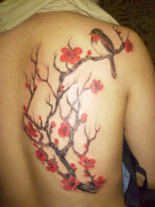 Blooming flowers with bird tattoos
