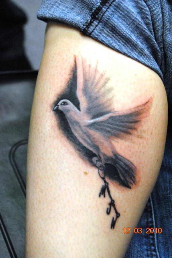 Dove tattoo on leg