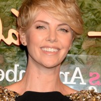 Charlize Theron Layered Short Messy Hairstyle with Bangs