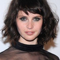 Felicity Jones Short Messy Dark Curly Hairstyle