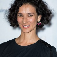 Indira Varma Short Black Curly Hairstyle