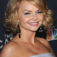 Izabella Miko Short Blonde Curly Hairstyle with Side Swept Bangs for Heart Faces
