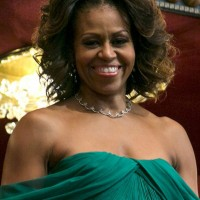 Michelle Obama Short Curly Hairstyle for Black Women