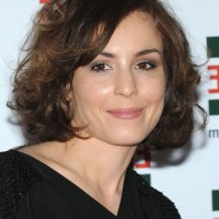Noomi Rapace Short Curly Hairstyle for Round Faces