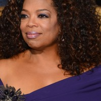 African American Naturally Curly Hairstyle for Medium Hair from Oprah Winfrey