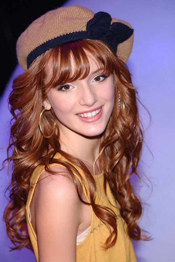 Bella Thorne Tousled Red Curly Hairstyle With Wispy Bangs