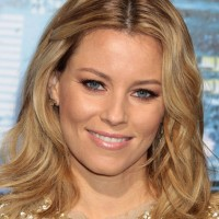 Celebrity Layered Medium Wavy Hairstyle from Elizabeth Banks