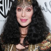 Cher Medium Black Curly Hairstyle for Women Over 60