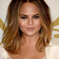 Chrissy Teigen Medium Ombre Wavy Hairstyle for Round Faces