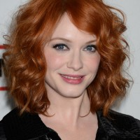 Christina Hendricks Medium Red Curly Hairstyle for Mature Women