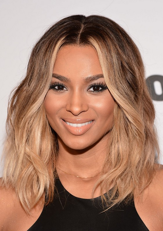 Ciara Honey Blonde Medium Wavy Hairstyle For Black Women