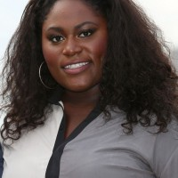 Danielle Brooks Medium Black Curly Hairstyle for Black Women
