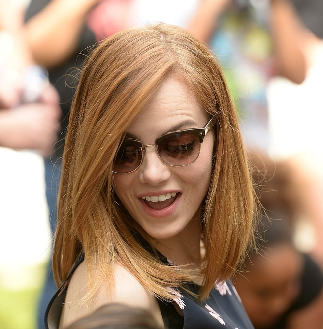 emma stone medium straight bob hairstyle with bangs for