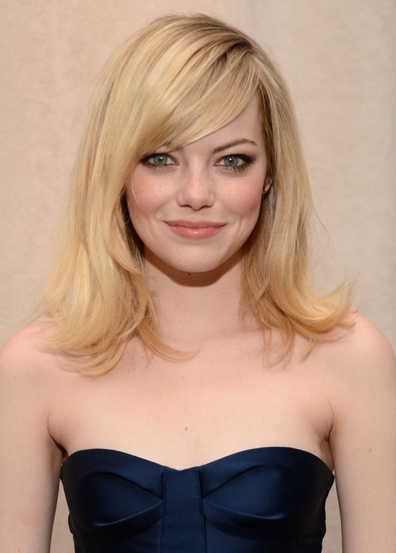 emma stone medium straight hairstyle with side swept bangs