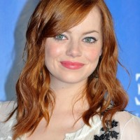 Emma Stone Shoulder Length Red Wavy Hairstyle with Side Swept Bangs