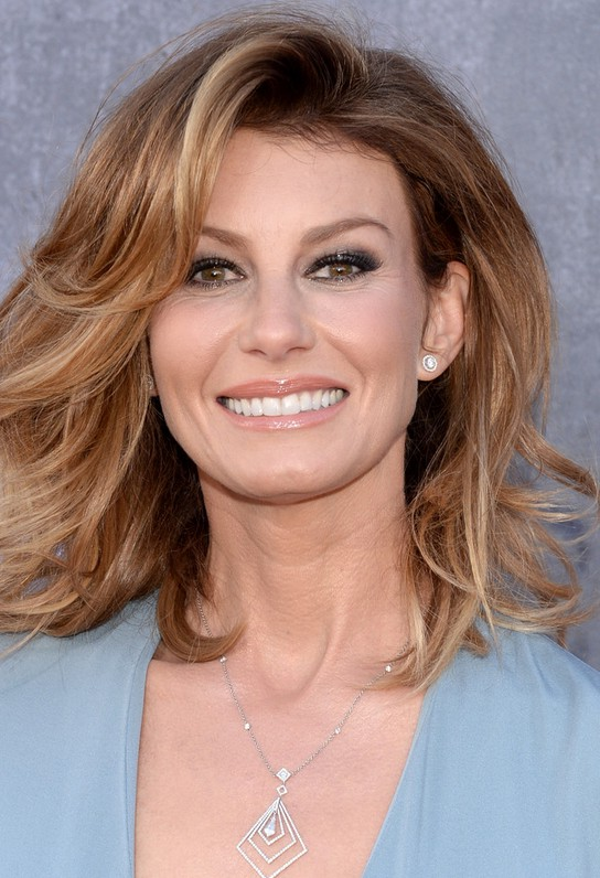 Faith Hill Medium Wavy Haircut for Women Over 50 | Styles Weekly