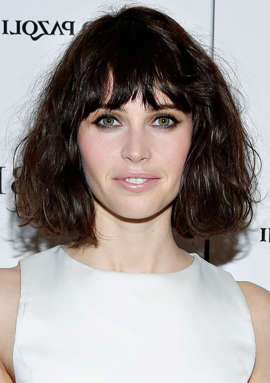 Felicity Jones Short Wavy Haircut with Choppy Bangs