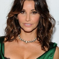 Gina Gershon Layered Medium Wavy Hairstyle for Women Over 50