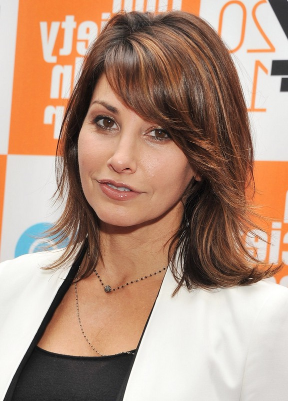 Gina Gershon Trendy Medium Wavy Hairstyle with Layers for Thick Hair ...