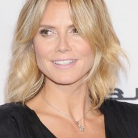 Heidi Klum Latest Medium Blonde Wavy Hairstyle