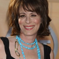 Jane Kaczmarek Layered Short Hairstyle with Bangs for Women Over 50