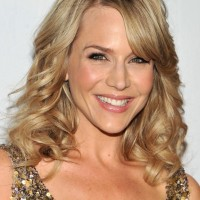 Julie Benz Shoulder Length Curly Hairstyle with Side Swept Bangs
