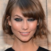 Karlie Kloss Cute Short Wavy Hairstyle with Bangs
