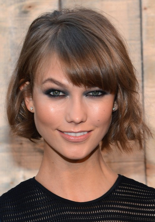 Karlie Kloss Cute Short Wavy Hairstyle with Bangs