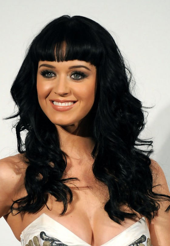 Katy Perry Long Black Curly Hairstyle With Blunt Bangs