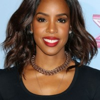 Kelly Rowland Center Parted Dark Wavy Hairstyle