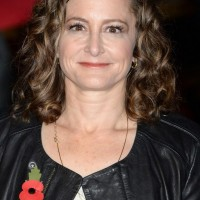 Nina Jacobson Shoulder Length Curly Hairstyle for Round Faces
