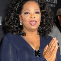 Oprah Winfrey Shoulder Length Black Curly Hairstyle for Women Over 50