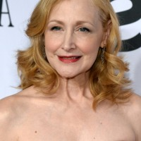 Patricia Clarkson Medium Blonde Curly Hairstyle for Women Over 50