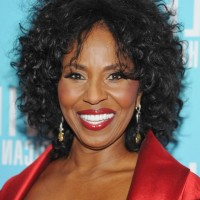Pauletta Washington Medium Black Curly Hairstyle for Women Over 60