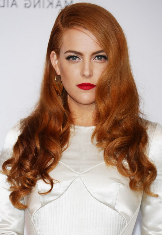 Riley Keough Deep Side Parted Copper Curly Hairstyle for Long Hair | Styles Weekly