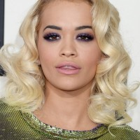 Rita Ora Medium Blonde Wavy Curly Hairstyle for Women