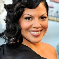 Sara Ramirez Elegant Medium Black Wavy Hairstyle with Bangs