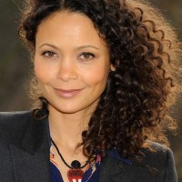 Thandie Newton Trendy Side Parted Curly Haircut for Medium Length Hair