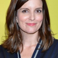 Tina Fey Latest Medium Brown Wavy Hairstyle for Oval Faces
