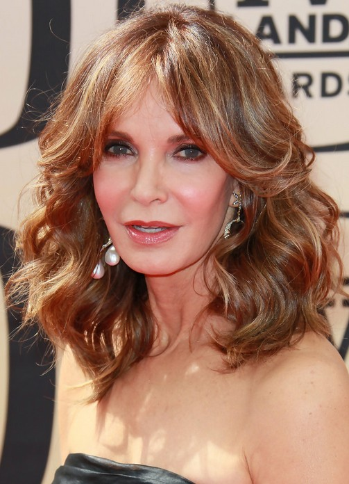 Jaclyn Smith Layered Medium Curly Hairstyle for Women Over 50