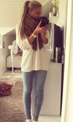 Oversized sweater, chunky scarf, stretchy pants and a ponytail....this would also look good with a high, messy bun!!!