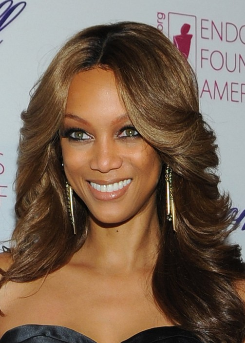 Tyra Banks Feathered Flip Hairstyles for Black Women