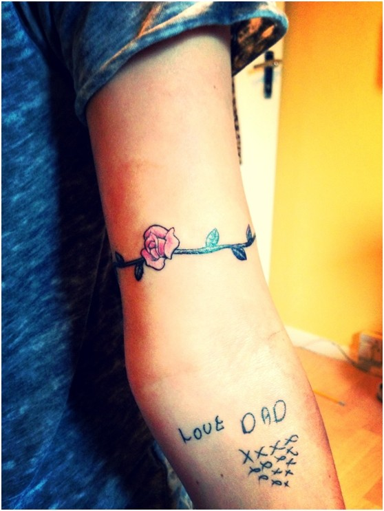Pretty Flower And Words Tattoo On The Arm