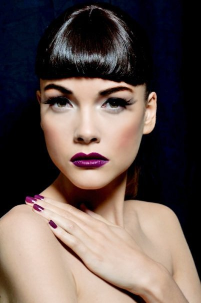 Chic Purple Lipstick Makeup Look with Long Lashes