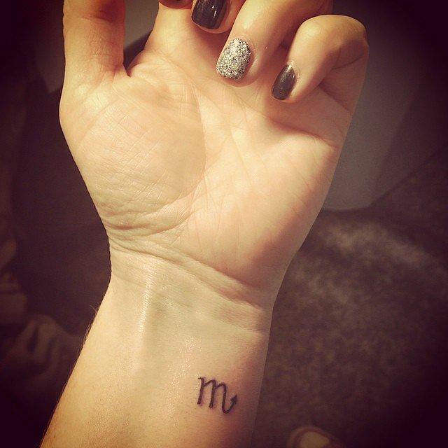 Scorpio-Symbol Tattoo for women