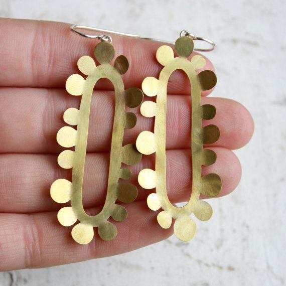 A pair of brass earrings