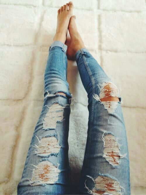 A pair of distressed jeans